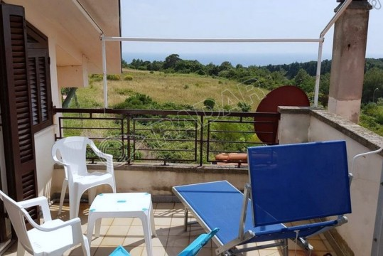 in a hilly area with solarium and sea view